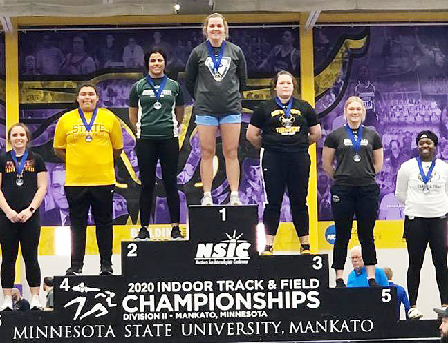 NSIC champion—Brinn Grunder, a former Durant grad and senior at Upper Iowa University, recently won the Northern Sun Intercollegiate Conference title in the shot put with a season-best throw of 14.97 meters. Brinn is pictured atop the podium of the 2020 Indoor Track & Field Championships held at Minnesota State University, Mankato.
