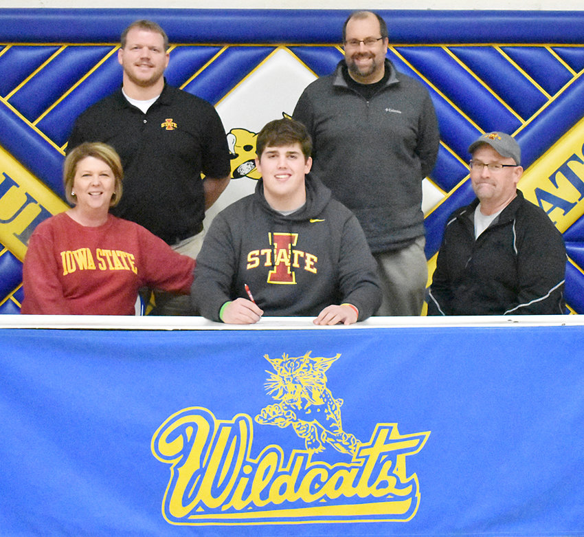 Durant senior Joe Lilienthal (middle) recently signed to become a preferred walk-on at Iowa State University. He'll battle for a spot on the Cyclone football team's offensive line in hopes of eventually landing a scholarship. Previously verbally committed to South Dakota, Lilienthal said that Iowa State's ag programs helped sway his commitment, as he plans to study ag business and eventually farm with his father. He's pictured above with his parents Steph and Mike Lilienthal, and coaches (standing) Dan Knipfel and Joel Diederichs.