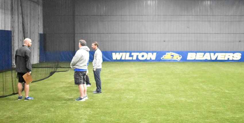 Wilton Athletic Director Ryan Hetzler (left) is shown above meeting with coaches Jake Souhrada, Kortney Denkman and Nick Dohrmann in the school district's new indoor multipurpose facility that boasts a field turf surface, batting cage, restrooms, storage, etc. Funded primarily by the Townsend Foundation, the facility is available for school and public use.