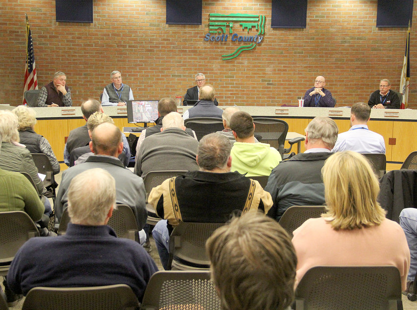 A March 5 hearing at the Scott County Administration Center drew about 40 people to discuss a proposed hog confinement expansion near Maysville.