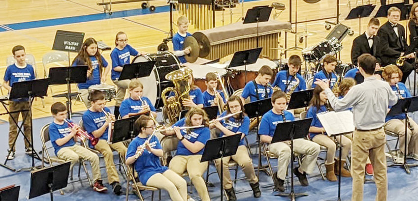 The Wilton 5-12 grade bands hosted their annual spring concert on March 2 in the Wilton High School gym. Band members from Wilton elementary are shown performing. Upcoming band events include: SEIBA Large Group Band Festival March 7; Elementary Solo Contest March 17; 3-4 grade concert March 19; 5-6 grade concert April 23; high school graduation performance May 17; 5-8 grade band concert May 19; and Memorial Day parade performance May 25.
