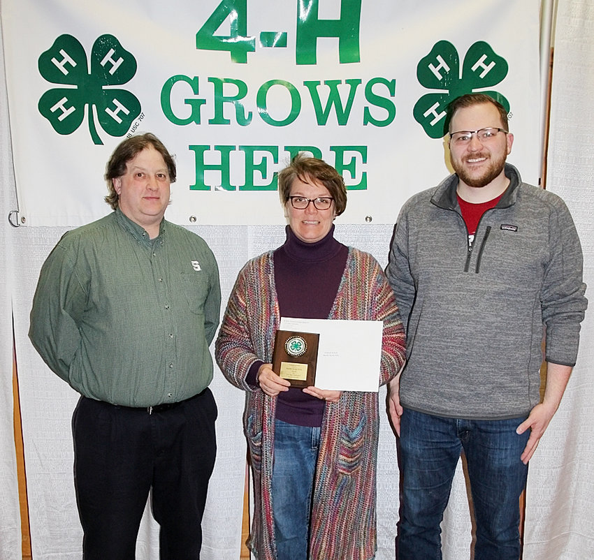 The Honorary 4-H Award was presented to Roy Shaft (left). The Friends of 4-H Award was given to the North Scott FFA, represented by Jen Westphal and Jacob Hunter.