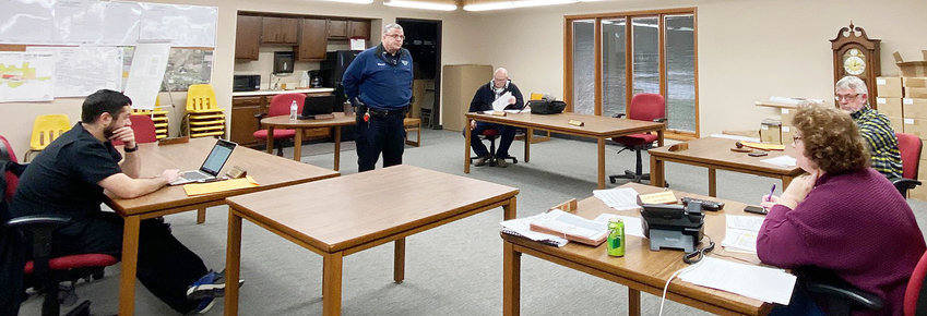 Durant city officials practiced social distancing techniques during a March 23 city council meeting. Police Chief Orville Randolph is shown (middle) keeping plenty of distance from officials while discussing upcoming police department purchases.