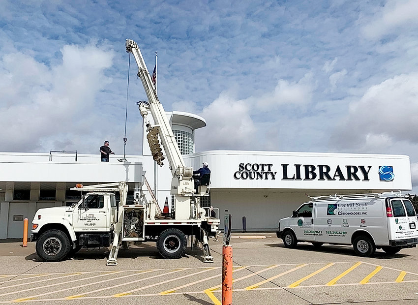 Employees of Central Scott Telephone, Scott County and Lighting Maintenance, Inc. (LMI) banded together on Saturday, March 21 to install an outdoor AP device that provides free public Wi-Fi in Scott County Library parking lot in Eldridge.