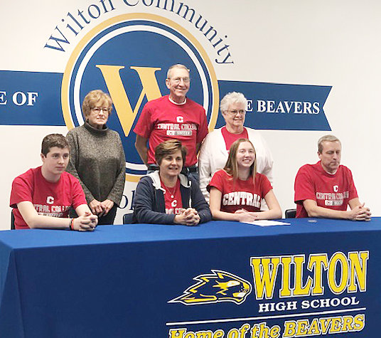"""Wilton senior Emmy Drake recently signed a letter of intent to play soccer for Central College in Pella. She has played soccer for Muscatine High School the last three years and is looking to play her senior year with the team. She also played for the Muscatine Soccer Club and the Iowa Soccer Club in Iowa City in the past. When asked why she chose Central, Emmy said, """"I went to their soccer camp and really enjoyed the coaching staff and the girls on the team. It's definitely a family atmosphere and I feel like it's a great place for me to continue my soccer career."""" She plans to major in political science. Pictured with Emmy is (front from left) brother Ethan Drake, mother Shelley Drake, and father Kevin Drake; back row, grandparents Amber Owens, Don and Nancy Drake."""
