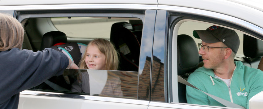 Kindergartener Stella Steinbeck and her dad, Matt, greet Ed White Elementary staff while stopping by to pick up belongings left at spring break.  Stella will finish kindergarten at home and return as a first-grader.
