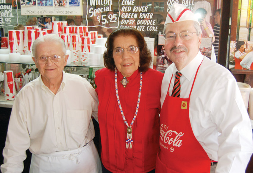 George and Thelma Nopoulos, shown above with longtime Iowa Gov. Terry Branstad, during one of his many visits to the Wilton Candy Kitchen. Currently the U.S. Ambassador to China, Branstad called to express his sympathy for Thelma, who passed away over the weekend at the age of 88.