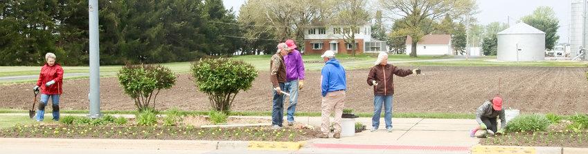 From left: Eldridge Lions Club members Nadine Schwartz, Jim Gruber, Merlyn Frick, Al Mohr, Nancy Gruber and Judi Sarafin plant flower beds on Eldridge's East LeClaire Road.