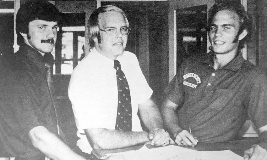Frank Wood, right, poses with his new hires in 1974: Girls' softball coach Dennis Johnson and wrestling coach Roger Kirby.