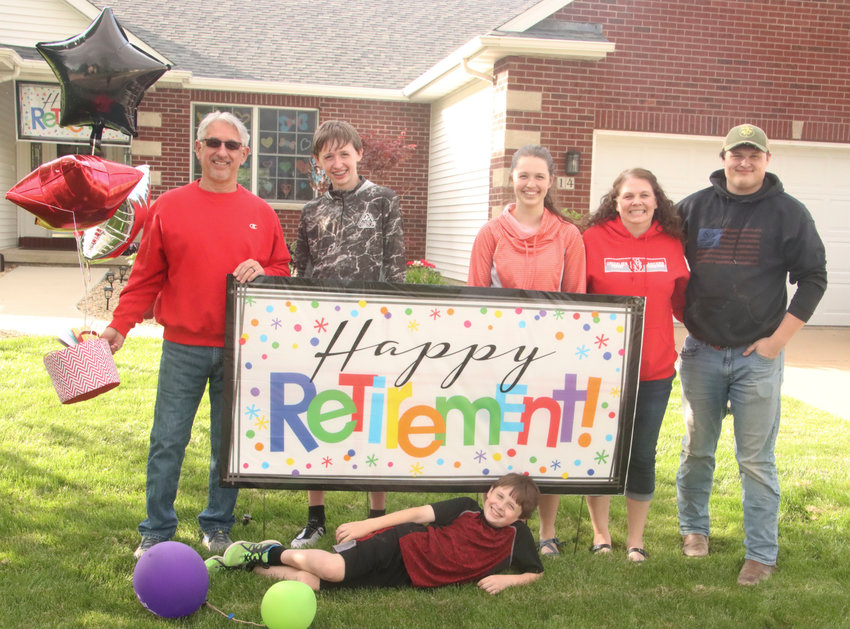 After his surprise retirement parade, Kelly Rohlf posed for a picture with his family. Front: Kellen. Back (l-r): Rohlf, Kale, Kara, wife Michele and Kyle.