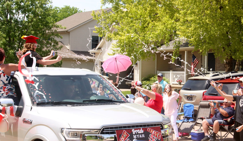 The parade route went directly past senior Myah Herrington's home on Pinehurst Drive, and family and friends were waiting with a fun-filled reception.