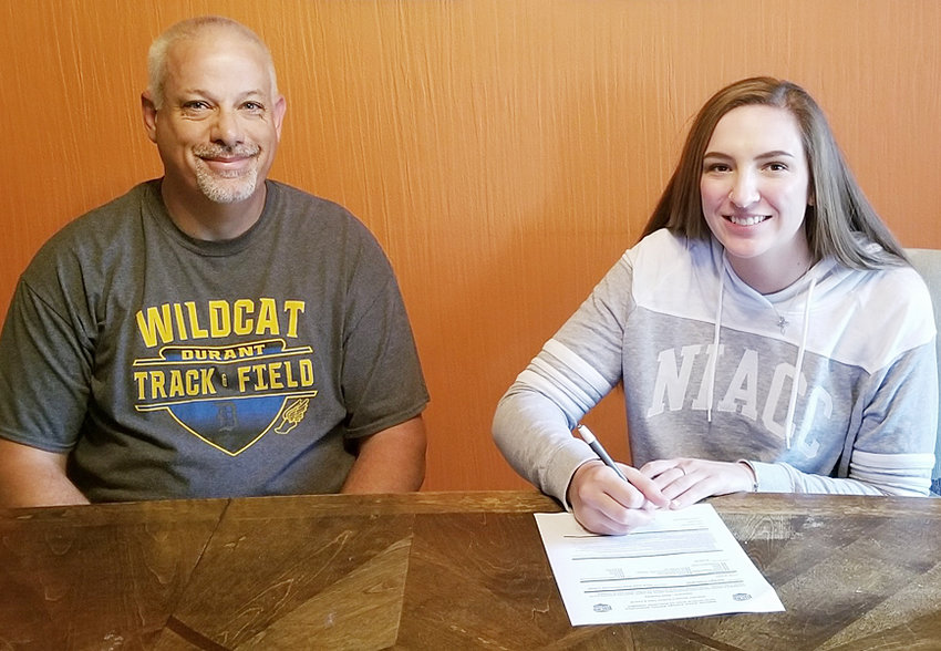 "Durant senior Jordyn Ostrand (right) recently signed a letter of intent to throw shot put and discus on the North Iowa Area Community College track team in Mason City. The daughter of Janelle Entsminger and Paul Ostrand, Jordyn plans to major in athletic training while in college. Pictured above with Durant girls' track coach Doug Frett, Jordyn said she feels like she's a ""part of family"" with the new staff and team at North Iowa Area Community College."