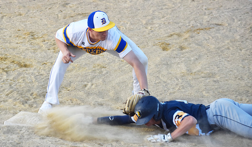 The Durant baseball team started the 2020 season with a 5-4 home loss to Regina. The Cats played from behind most of the game, falling a run short. Third baseman Ben Orr is shown below tagging a Regal runner for an out on a pick-off from pitcher Brendan Paper during the first home game of an upcoming abbreviated season.