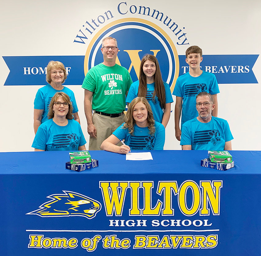 """Wilton senior Taylor Garvin recently signed a letter of intent to play golf at St. Ambrose University in Davenport. When asked why she chose St. Ambrose, Taylor said, """"I believe St. Ambrose will give me opportunities to excel as a student and athlete. After numerous college campus visits, I felt the greatest connection with SAU's faculty, coaches, and campus."""" Garvin plans to major in biochemistry while on a pre-dental/med track. Taylor (middle) is pictured above with (seated) parents Kelly Garvin and Gregg Garvin; and (back row from left) grandmother Rita Dykstra, Wilton coach Jamie Meyer, sister Alexa Garvin and brother Gunner Garvin."""