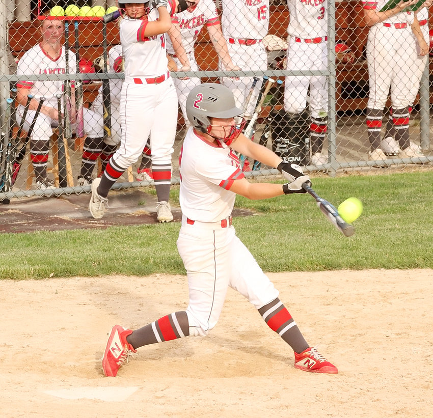 North Scott senior Sam Lee drills her first home run of the year with this two-run shot in the fifth inning of Thursday's 7-5 loss to Muscatine.