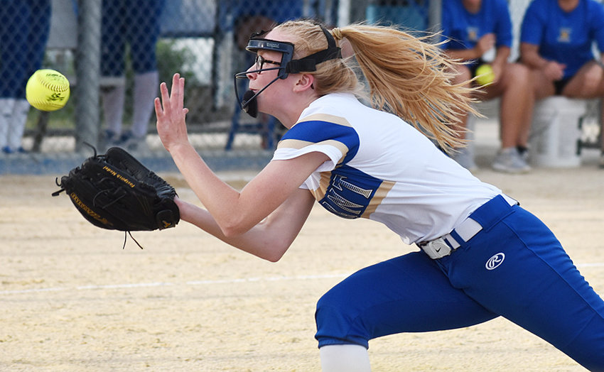 Durant pitcher Shannon Head dives to make a play on a short pop-up bunt attempt in home action against Northeast June 18.
