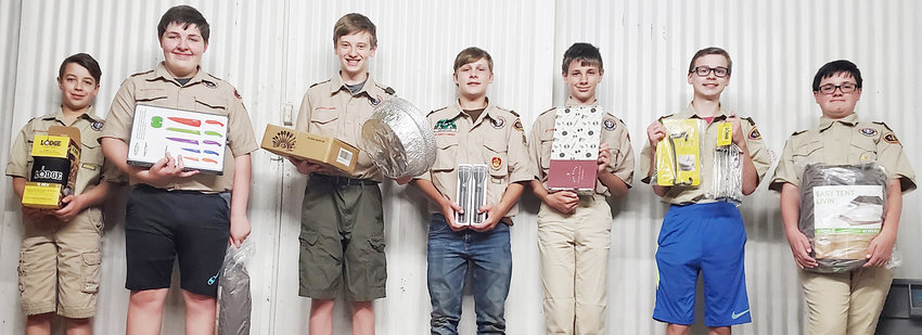 After a Facebook post from local Scoutmaster Ritchie Creamer went viral last week, local Scout Troop 151 began receiving multiple donations from area residents in the wake of the group being unable to rent out tents due to multiples being damaged. Pictured above with gifts that began to come in Monday include (from left) Tyler Ellithorpe, Dominic James, Grayson Hartung,  Connor Skubal, Evan Miller, Gabriel Breed and Colton Miller.