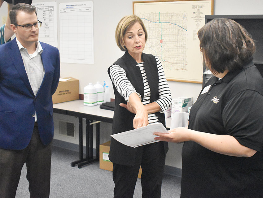 Iowa Governor Kim Reynolds (middle) visited the Cedar County Emergency Management Agency (EMA) in Tipton with Lt. Gov. Adam Gregg June 22, to review how Cedar County has battled COVID-19. The governor also reviewed Cedar County EMA personal protective equipment (PPE) distribution methods. Reynolds and Gregg are pictured above with Jodi Freet of the Cedar County EMA.