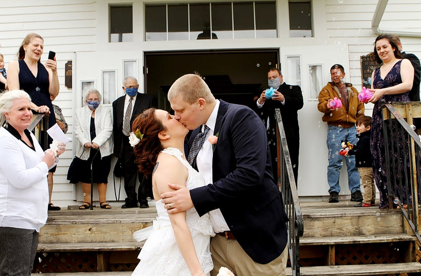 Sarah and Joe Rymars wed at a Summit Church ceremony in advance of his deployment to Qatar.