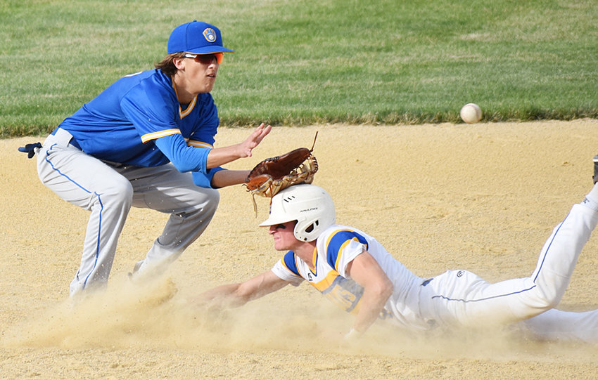 Durant's Jake Willkomm slides safely into second base in home action against Wilton, despite the glove of second baseman Chase Garvin resting on his head while awaiting a throw from the plate.