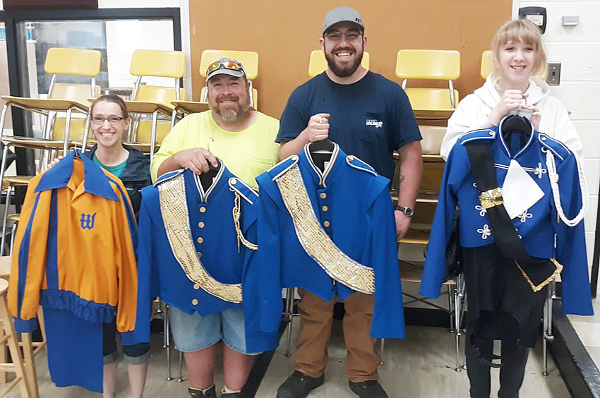 The 27-year old Wilton High School Marching Band uniforms were transported to their new home at Moulton-Udell Community School in Moulton, Iowa in late May. Their original destination was a school in Chicago but due to the COVID-19 pandemic, alternative plans had to be made, according to former Wilton band director Pete Wyatt. Pictured, above left, are the Wilton Marching Band uniforms from the past 40 years. Cassie (Ervin) Parrott wore the uniform style on the left her freshman year and wore the middle uniform style after that. Richard and son Jacob Creamer were part of the first and last classes to use the middle uniforms. Cassie's daughter Malea Parrott wore the old uniforms for two years before becoming part of the first group to use the new uniforms last fall. The uniforms on the left were donated to an inner city school in 1993. The middle uniforms were used for 27 years (most uniforms last 10-15 years according to Wyatt) and were donated in May.