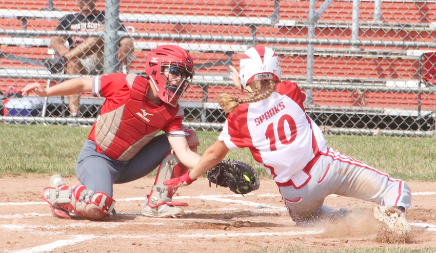 North Scott senior Sam Lee blocks the plate and puts the tag on Davenport West's Kaylynn Sparks in the Lancers' 10-8 win Thursday morning.
