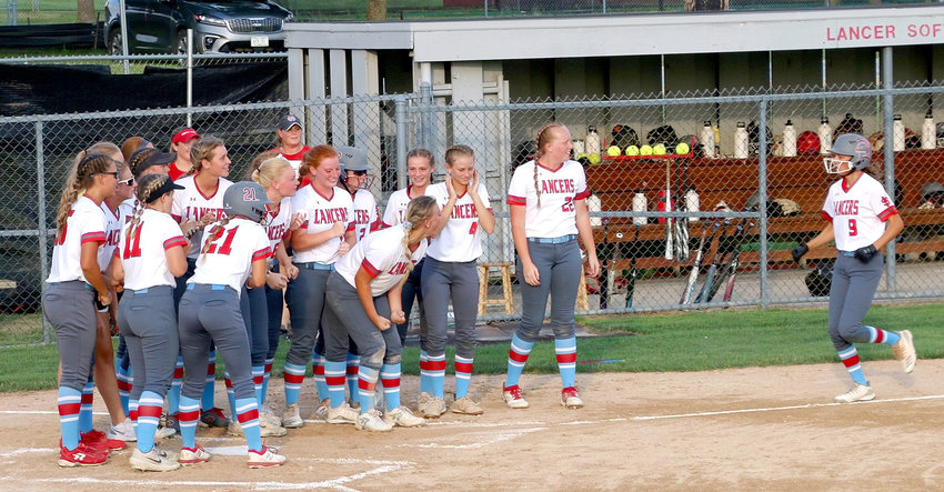 North Scott senior Brooke Kilburg received a rousing reception after her leadoff home run in the bottom of the first inning against Wahlert Catholic Saturday night.