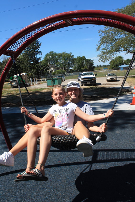Brielle Page and Sairse Wickman try the giant swing at the new Kimberly Park playground in opening hours last Thursday.
