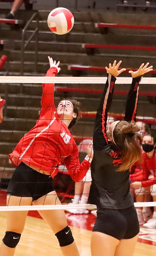Junior Calla Brunkan keeps her eye on the ball as she delivers a spike against Clinton.