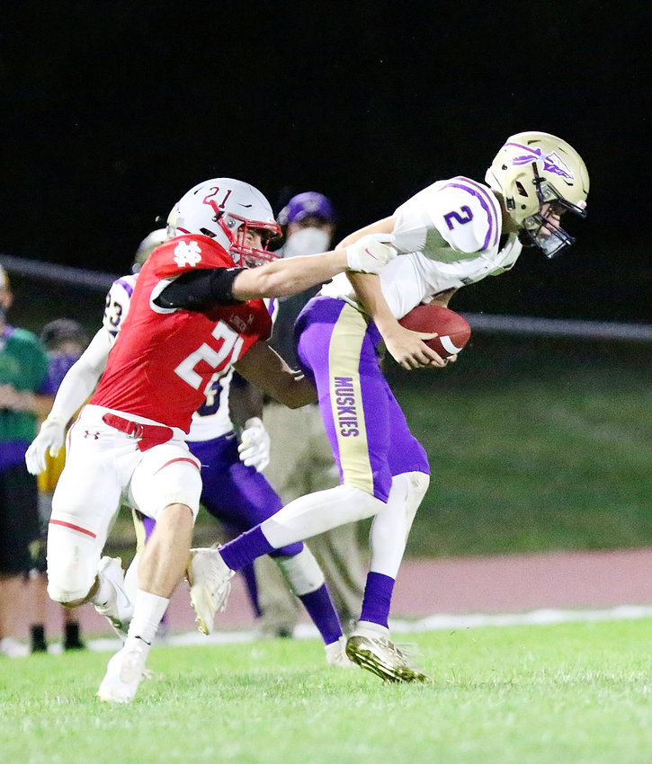 NS senior Grant Moeller sacks Muskie QB Jake Draves for one of his team-high seven tackles.