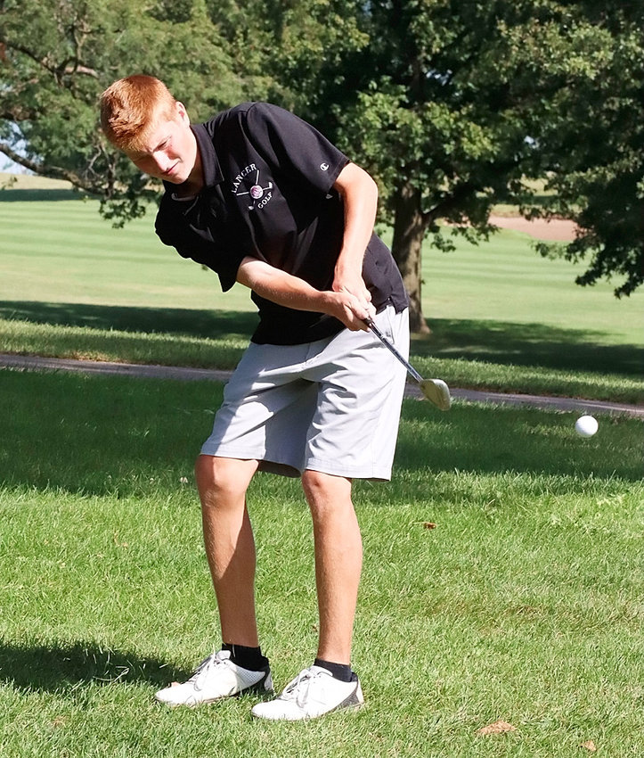 Junior Eli Engelkes chips onto the fifth green at Emeis, where he led the Lancers with a round of 86 at the Assumption Invite.