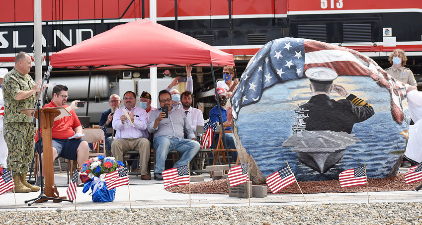 Special guest speaker and Wilton native Rear Admiral Will Pennington, left, reacts moments after the Muscatine County Freedom Rock was unveiled in downtown Wilton Sept. 6. The Freedom Rock site is located near the Wilton Depot at the intersection of Maurer and Railroad streets.