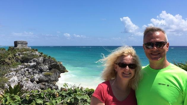 Cruise Planners franchise owners and travel advisors Brad and Angela Striegel at the ancient Mayan ruins in Tulum, Mexico.