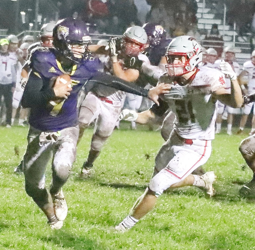 NS senior Grant Moeller puts pressure on Central DeWitt quarterback Henry Blook during second-quarter action Friday night.