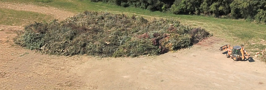 An Eldridge drone photographed this aerial view of the city's derecho debris pile east of the Buttermilk Road lagoons