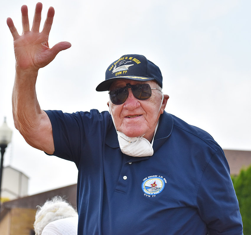 Former Wilton United Methodist Church Pastor Paul Pennington is shown waving to the crowd at the Muscatine County Freedom Rock dedication Sept. 6. He traveled back to Wilton with his wife Sharon to view the ceremony, where their son Will Pennington was a guest speaker.