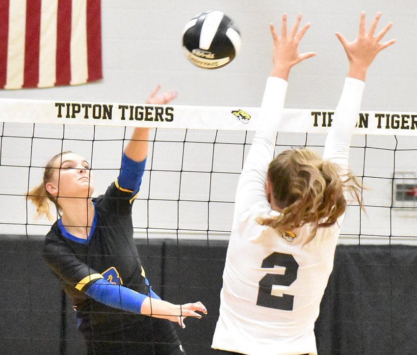 Durant's Rylie Rock (left) makes a kill attempt in road action at Tipton Sept. 15. The Wildcats defeated Tipton in five 23-25, 25-19, 25-19, 23-25, 15-12.