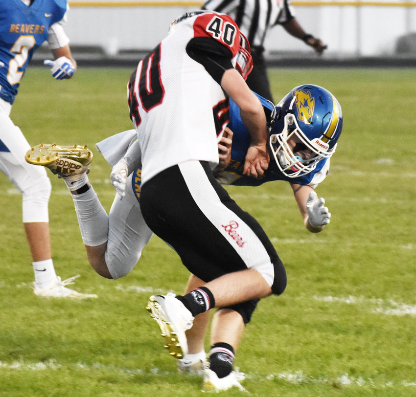 Wilton's Kael Brisker flies through the air to make a hit on West Branch's Kaleb Sexton in home action Sept. 18. The visiting Bears defeated Wilton 43-8.