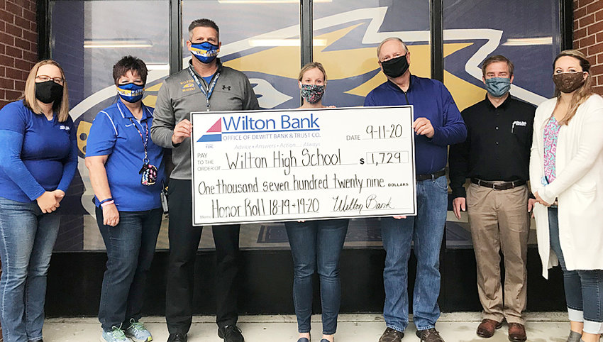 Wilton Bank supports the honor roll program at Wilton and Durant high schools. Wilton Bank donates $1 each quarter for every student who makes the honor roll. The money donated is used to enrich academic programs and schools. Wilton Bank donated $2,413 for the 2019–2020 school year — giving $1,729 to Wilton High School, this included the 2018-19 school year that was not presented in the spring of 2020, and $684 to Durant High School. Since the 2014–15 school year, Wilton Bank has donated $7,734 to the local schools. Pictured during the check presentation at Wilton High School are Amber Pulliam, Jill Proctor, Marc Snavely, Missy Drayfahl, Bill Vetter, Ben Brown and Hailey Mullen.
