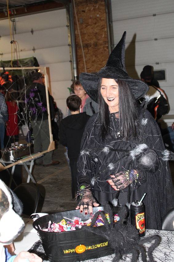 Last year's Halloween celebration in Atalissa included a trunk and treat event held at the Atalissa Fire station, where the Index captured this wicked lady handing out treats.