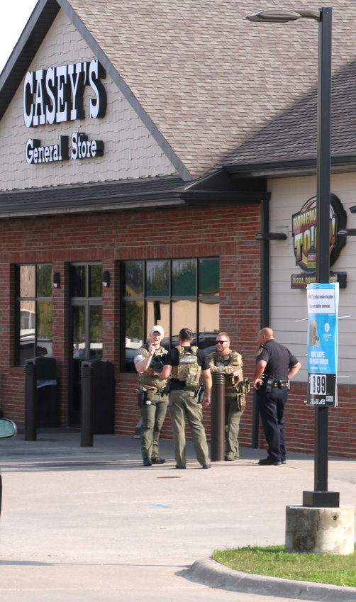 Deputies gather outside the Casey's.