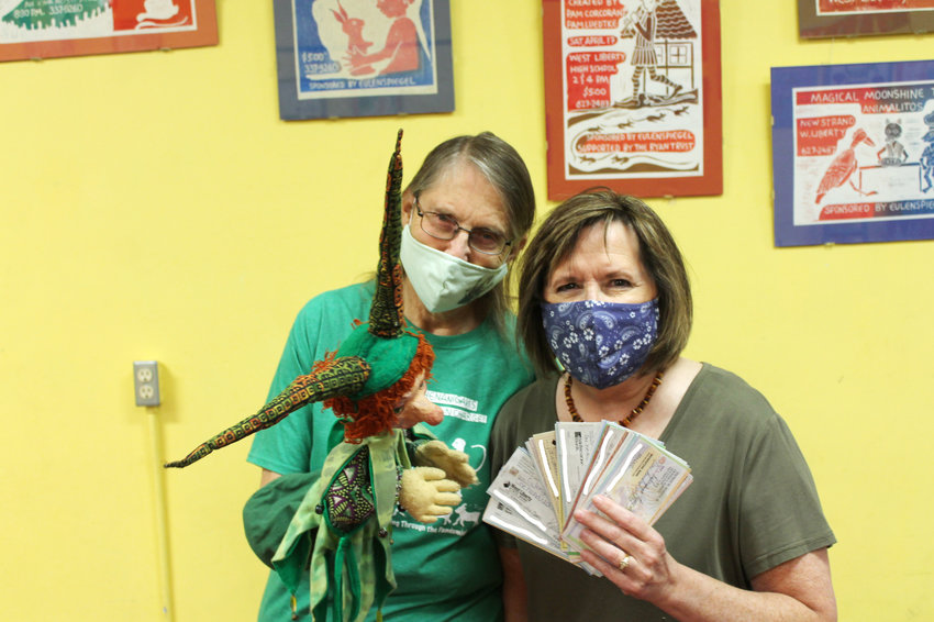 Monico Leo, with puppet friend, gets a fan full of checks totaling $6,700 from 100-plus Women Who Care