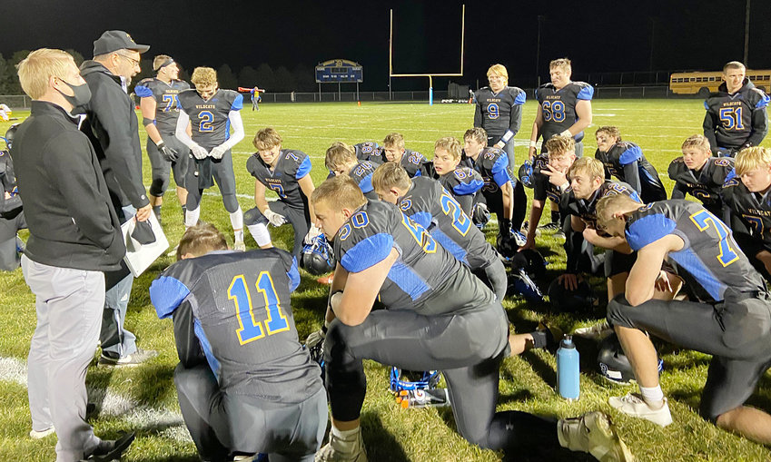 Durant head coach Joel Diederichs (left) speaks to his team moments after defeating Louisa-Muscatine 55-21 to secure the school's first ever playoff victory Oct. 16. The Wildcats (4-3) won the game on their home field, and will travel to Dyersville Beckman Oct. 23 for second round Class 1A action. It will be a rematch at Beckman, where Durant lost 24-17 earlier this season.