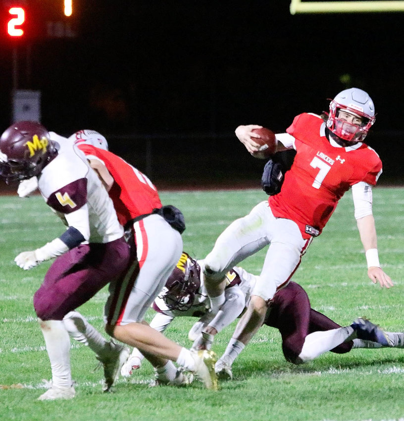 After an uncharacteristic slow start, North Scott's pistol offense finally found traction in the second half against Fairfield, and it turned out to be a magical night for senior quarterback Carter Markham (7). With more escapes than Houdini, Markham rushed for 275 yards and four touchdowns.