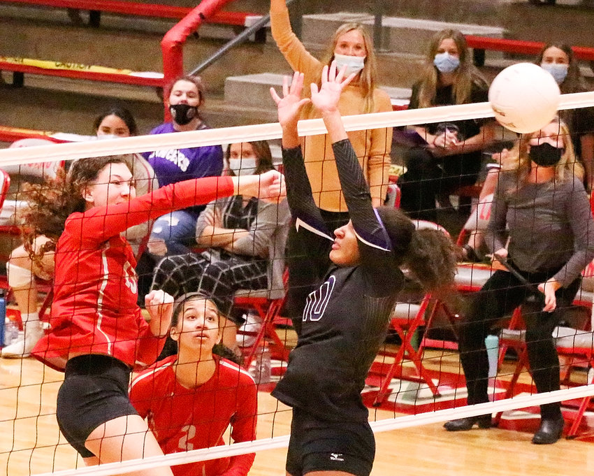 Lancer junior Scout Kirshy powers through one of her five kills in the four-set victory over Burlington last week.