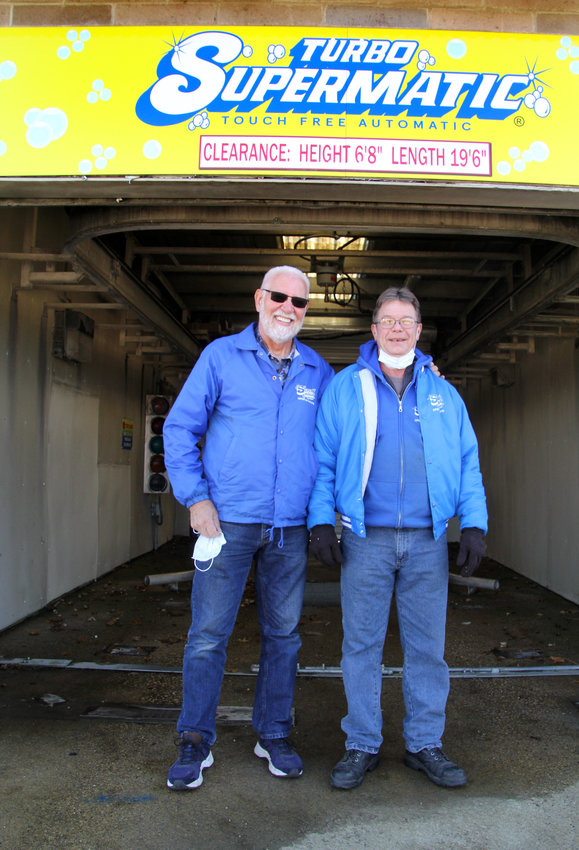 Dennis Boeck, left, and Randy Zeimet will be offering free washes in this brushless, automatic bay, and the self-service bays at the Eldridge SuperWash, 231 S. Ninth Ave.