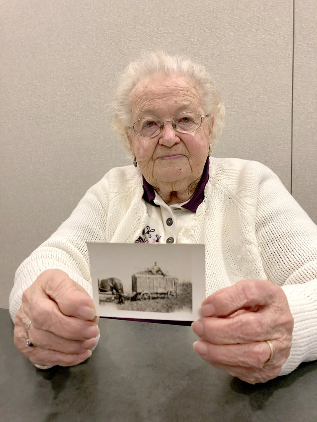 Dorla Schroder, and a photo from the 1940 National Corn Husking Championship in Scott County.