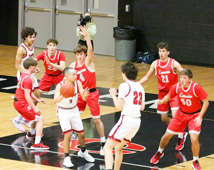 Playing good defense will be the key to North Scott's success this season, and the Lancers were locked in against Clinton on this possession. Lancers from left include Drew Kilburg, Landon Eiland, Ollie Hughes, Canon Guffey and Zach Johnson.