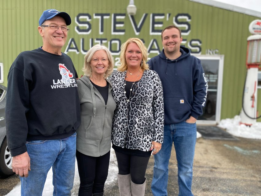 Steve and Michele Lindle (l) have sold their business, Steve's Auto Sales, to their daughter, Heidi Holst, and grandson, Brady Ernst.