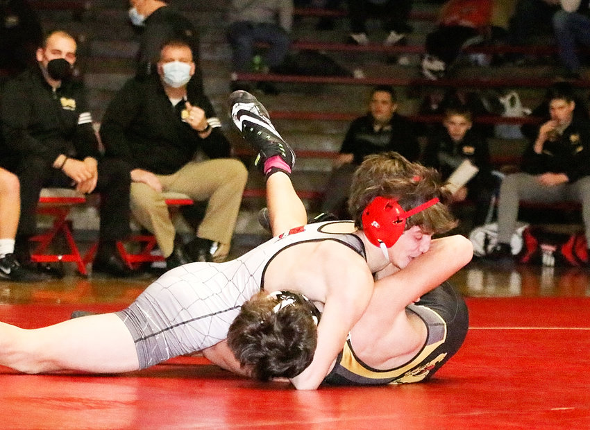 Lancer junior Cael Straley ignited the big uprising over Bettendorf with a meet-opening pin at 126 pounds.